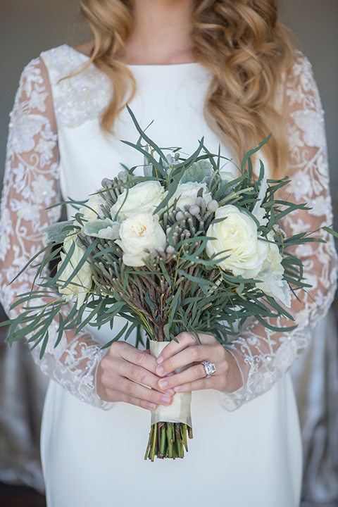 Orange-county-wedding-shoot-at-pasea-hotel-bride-lace-gown-with-sleeves-holding-floral-bridal-bouquet