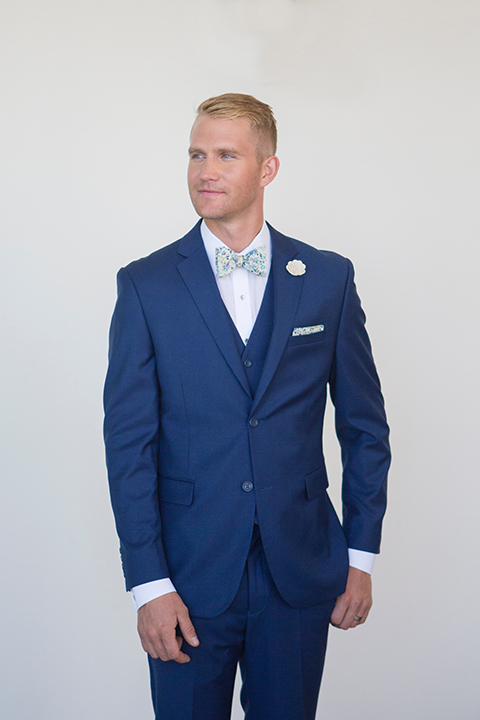 Orange-county-wedding-shoot-at-pasea-hotel-groom-blue-suit-with-floral-bow-tie
