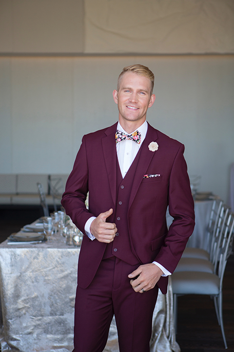 Orange-county-wedding-shoot-at-pasea-hotel-groom-burgundy-suit-with-a-floral-bow-tie-standing
