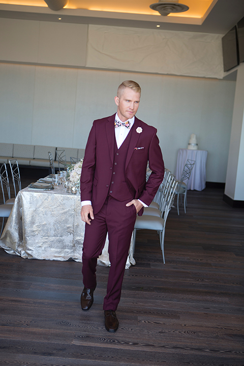 Orange-county-wedding-shoot-at-pasea-hotel-groom-burgundy-suit-with-a-floral-bow-tie-walking