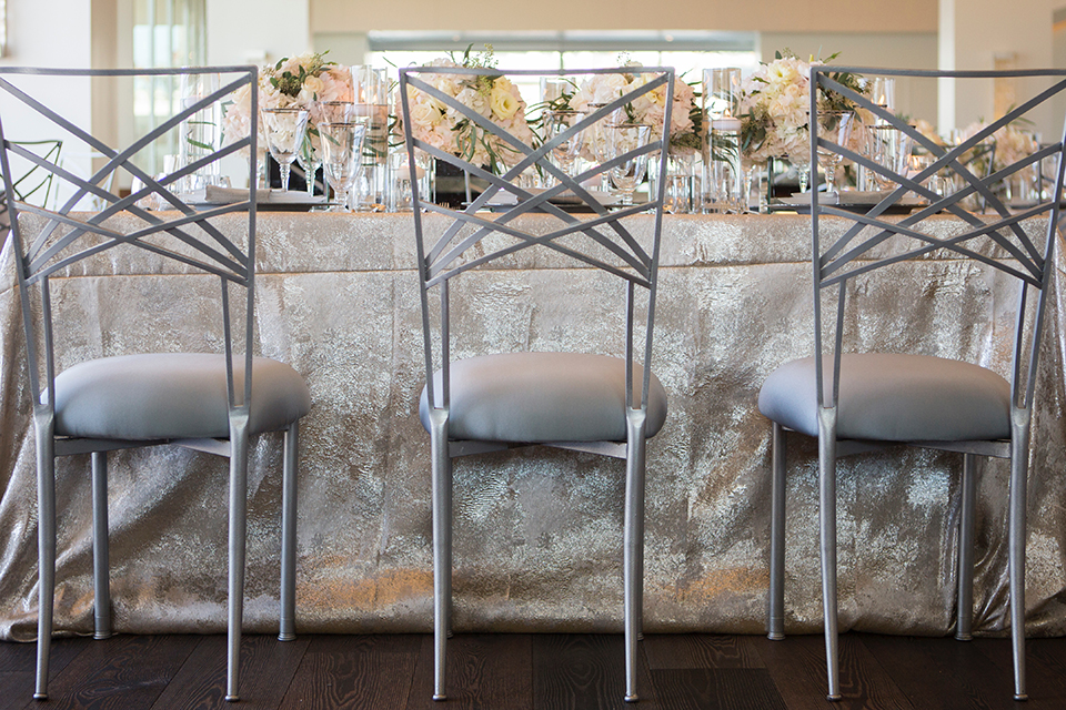 Orange-county-wedding-shoot-at-pasea-hotel-table-set-up-with-silver-table-linen-and-silver-chairs