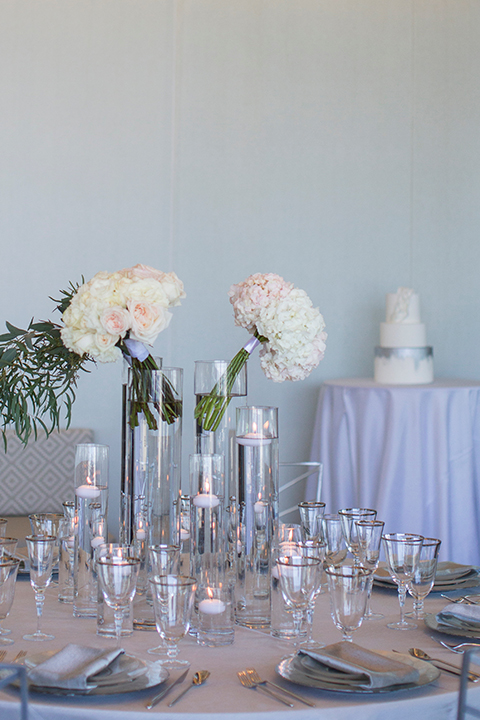 Orange-county-wedding-shoot-at-pasea-hotel-table-set-up-with-silver-table-linen-and-white-flower-decor