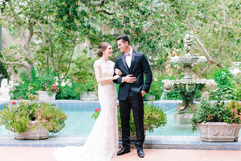 Rancho-las-lomas-outdoor-wedding-bride-and-groom-holding-arms