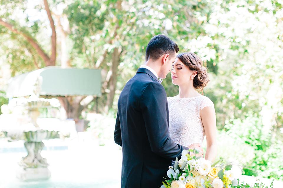 Rancho-las-lomas-outdoor-wedding-bride-and-groom-hugging-close-up