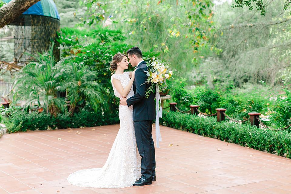 Rancho-las-lomas-outdoor-wedding-bride-and-groom-hugging-dancing