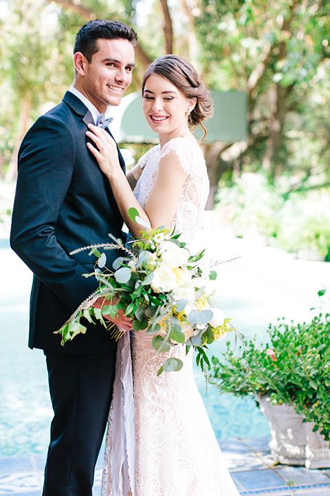 Rancho-las-lomas-outdoor-wedding-bride-and-groom-hugging-smiling