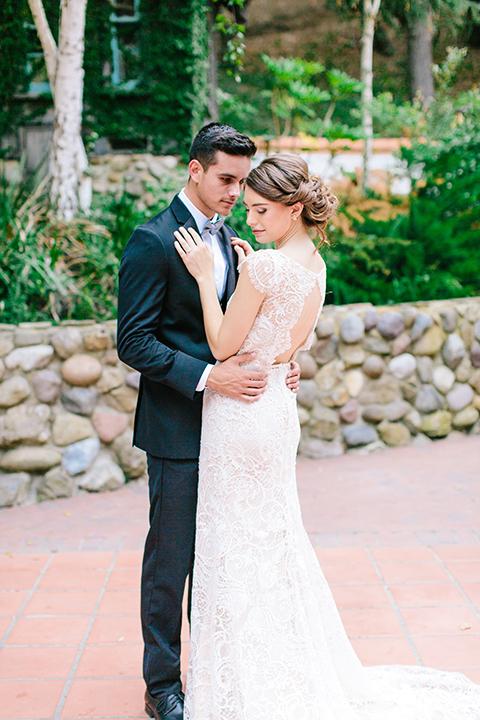 Rancho-las-lomas-outdoor-wedding-bride-and-groom-hugging-standing