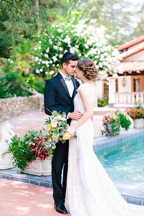 Rancho-las-lomas-outdoor-wedding-bride-and-groom-hugging