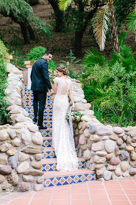 Rancho-las-lomas-outdoor-wedding-bride-and-groom-standing-and-walking-up-stairs