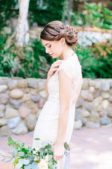 Rancho-las-lomas-outdoor-wedding-bride-holding-bouquet-close-up