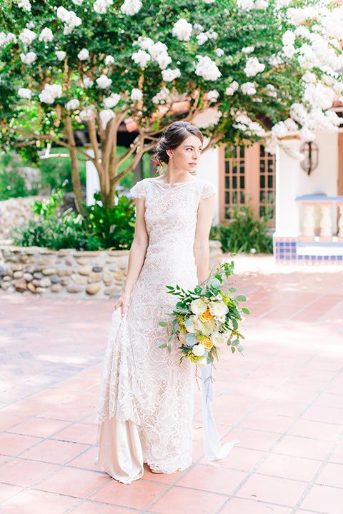 Rancho-las-lomas-outdoor-wedding-bride-holding-bouquet