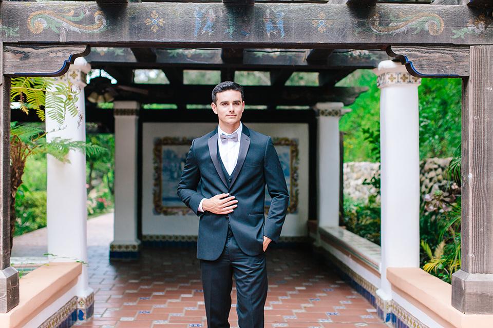 Rancho-las-lomas-outdoor-wedding-groom-black-tuxedo-close-up