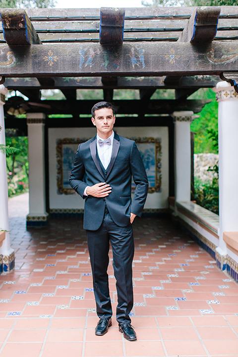 Rancho-las-lomas-outdoor-wedding-groom-black-tuxedo