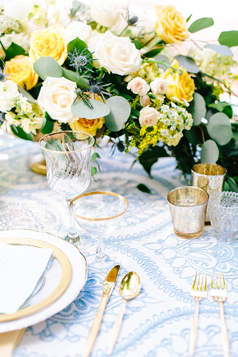 Rancho-las-lomas-outdoor-wedding-table-set-up-with-flowers-and-decor