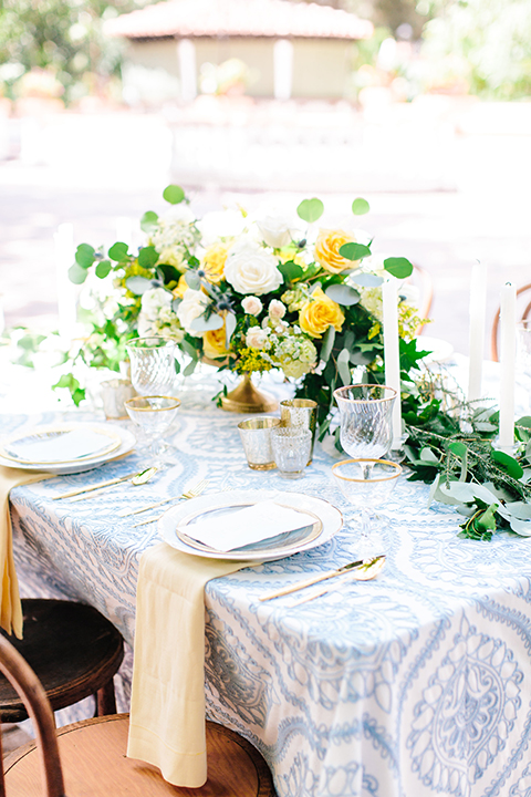 Rancho-las-lomas-outdoor-wedding-table-set-up-with-flowers-and-place-settings