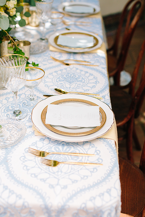 Rancho-las-lomas-outdoor-wedding-table-set-up-with-place-settings-and-chairs