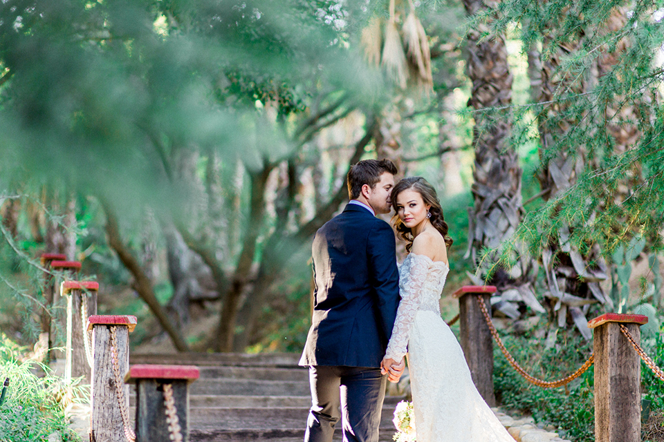 Rancho-las-lomas-outdoor-wedding-shoot-bride-and-groom-holding-hands-close-up