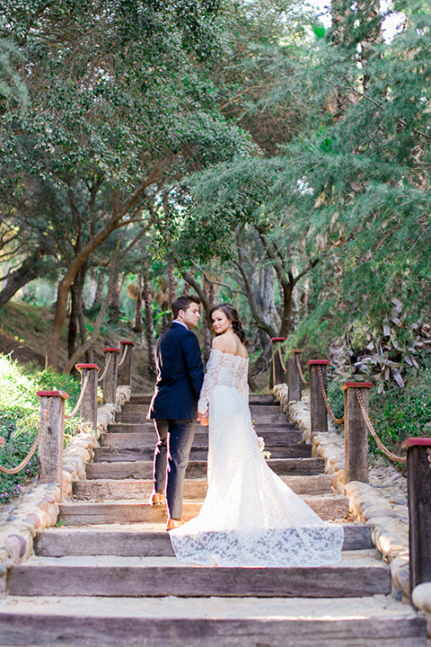 Rancho-las-lomas-outdoor-wedding-shoot-bride-and-groom-holding-hands