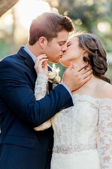 Rancho-las-lomas-outdoor-wedding-shoot-bride-and-groom-kissing