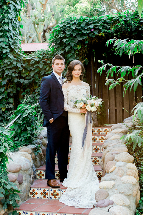 Rancho-las-lomas-outdoor-wedding-shoot-bride-and-groom-standing-holding-floral-bridal-bouquet