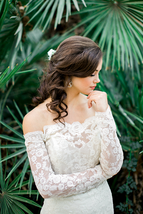 Rancho-las-lomas-outdoor-wedding-shoot-bride-lace-gown-with-long-sleeves-and-rose-gold-ring-and-flower-headpiece