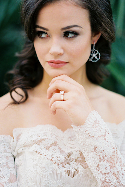 Rancho-las-lomas-outdoor-wedding-shoot-bride-lace-gown-with-long-sleeves-and-rose-gold-ring