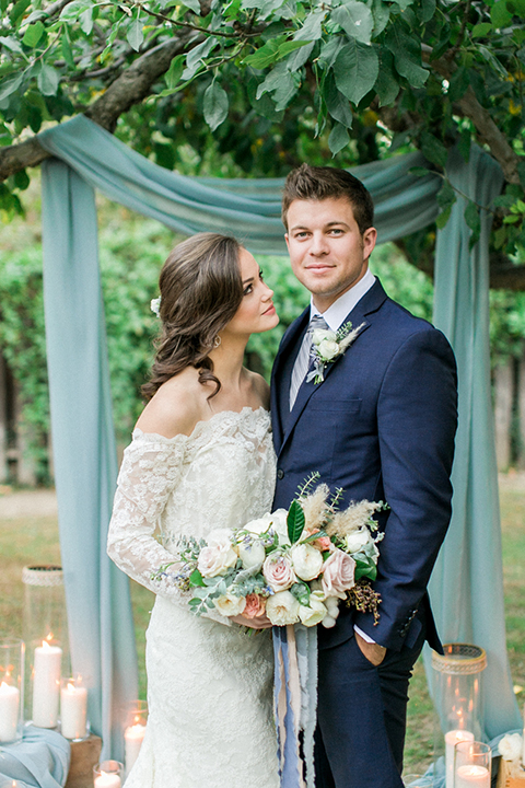 Rancho-las-lomas-outdoor-wedding-shoot-ceremony-bride-and-groom-hugging