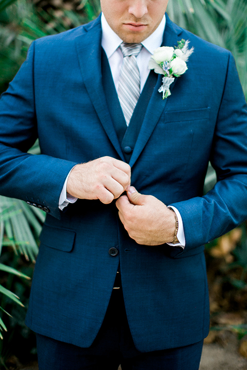 Rancho-las-lomas-outdoor-wedding-shoot-groom-cobalt-blue-suit-with-long-light-blue-striped-tie-close-up