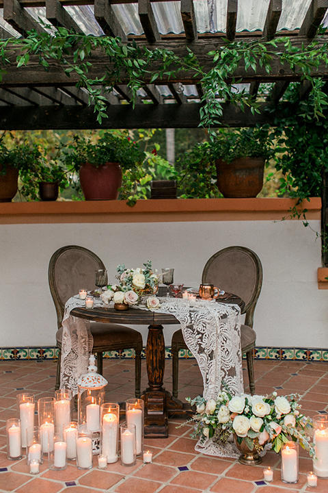 Rancho-las-lomas-outdoor-wedding-shoot-sweetheart-table-set-up-with-flower-and-candle-decor
