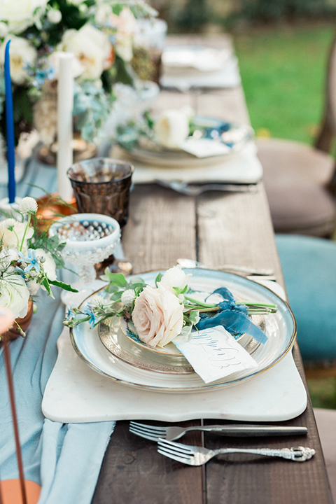 Rancho-las-lomas-outdoor-wedding-shoot-table-set-up-with-light-blue-table-runner-and-chairs-with-place-settings