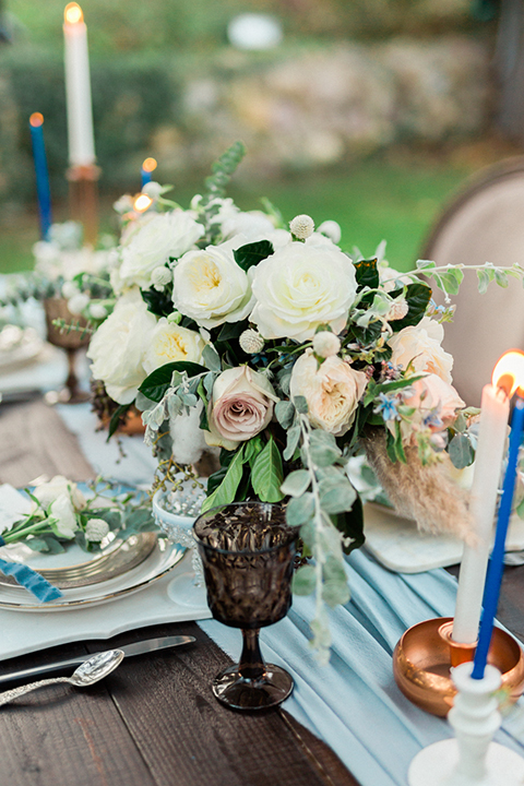 Rancho-las-lomas-outdoor-wedding-shoot-table-set-up-with-light-blue-table-runner-and-white-flower-centerpiece-decor