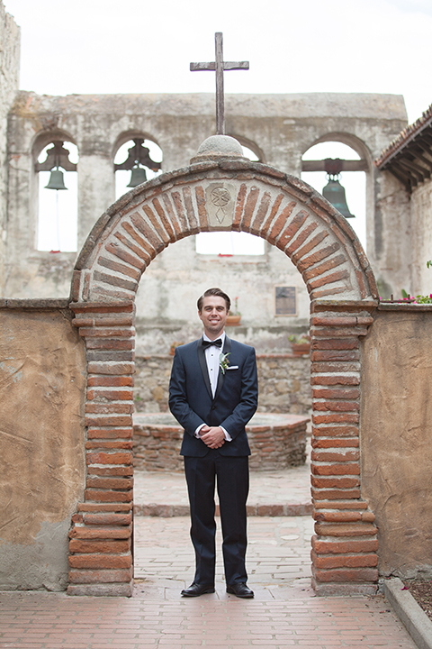 Rustic-wedding-at-the-villa-san-juan-capistrano-groom-standing