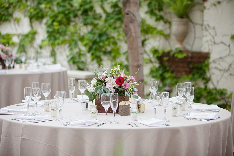 Rustic-wedding-at-the-villa-san-juan-capistrano-table-with-flowers