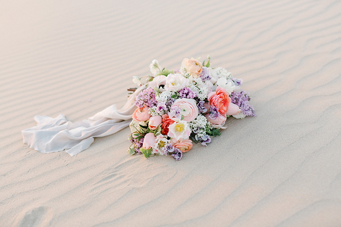 sand-dunes-wedding-shoot-bouquet-on-the-sand