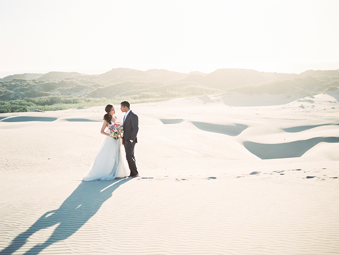 sand-dunes-wedding-shoot-bride-and-groom-footprints-in-sand