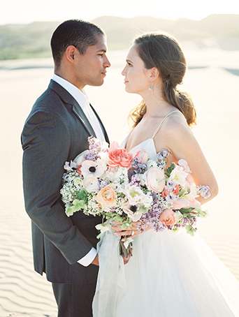 sand-dunes-wedding-shoot-bride-and-groom-holding-bouquet