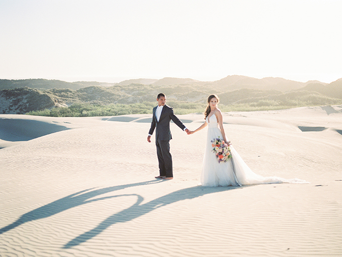 sand-dunes-wedding-shoot-bride-and-groom-holding-hands