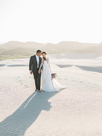 sand-dunes-wedding-shoot-bride-and-groom-hugging