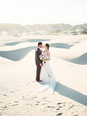 sand-dunes-wedding-shoot-bride-and-groom-looking-at-each-other
