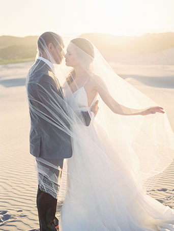 sand-dunes-wedding-shoot-bride-and-groom-under-veil