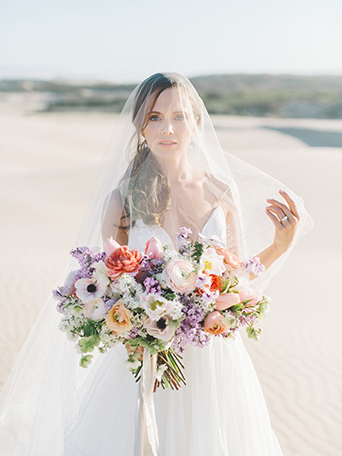 sand-dunes-wedding-shoot-bride-holding-veil