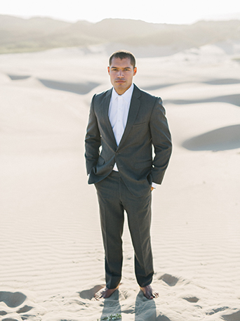 sand-dunes-wedding-shoot-groom-grey-suit-wiith-no-tie