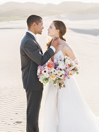 sand-dunes-wedding-shoot-groom-looking-at-bride