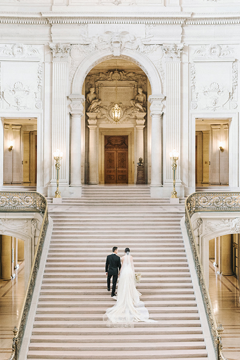 San-francisco-glamorous-wedding-at-city-hall-bride-and-groom standing-on-stairs-walking