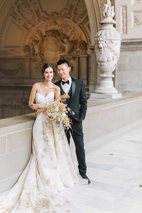 San-francisco-glamorous-wedding-at-city-hall-bride-and-groom-hugging-and-smiling