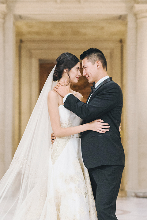San-francisco-glamorous-wedding-at-city-hall-bride-and-groom-smiling-and-hugging-close-up