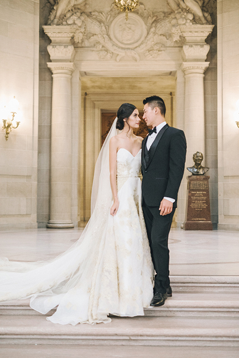 San-francisco-glamorous-wedding-at-city-hall-bride-and-groom-smiling-and-hugging