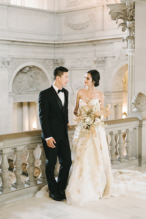 San-francisco-glamorous-wedding-at-city-hall-bride-and-groom-smiling-with-bouquet