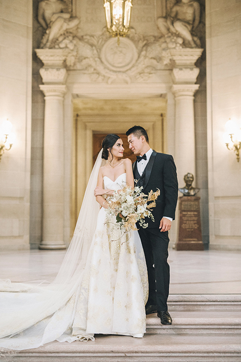 San-francisco-glamorous-wedding-at-city-hall-bride-and-groom-standing-with-bouquet