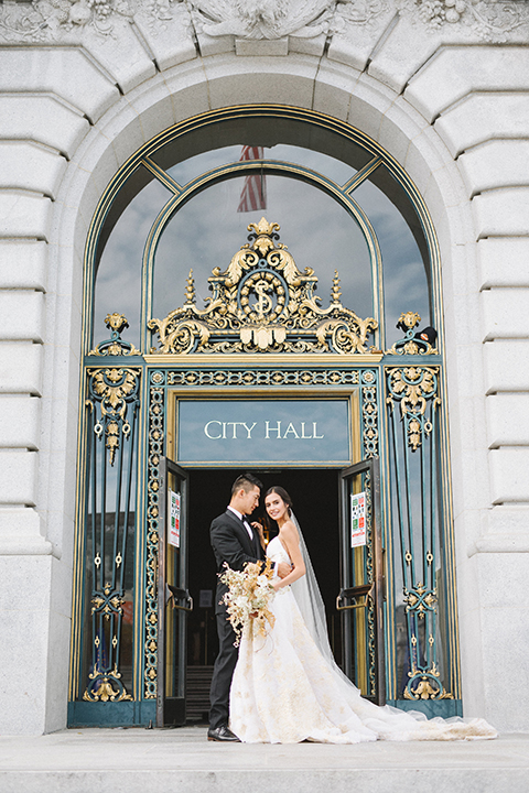 San-francisco-glamorous-wedding-at-city-hall-bride-and-groom-waiting-outside